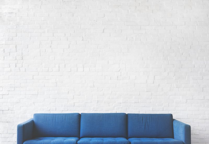 A blue sofa designed by upholsterers in Edinburgh.